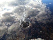 Small splash in lake stock photography