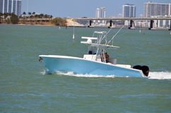 Small Sport Fishing Boat with a causeway bridge in the background Stock Photos