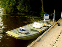 Small Sport Fishing Boat in Lake. Small sport fishing boat tied at dock in Trap Pond, Delaware Royalty Free Stock Photography