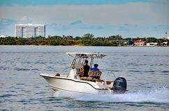 Small Sport Fishing Boat powered by a Single Outboard Engine Royalty Free Stock Images