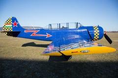 Small sport plane closeup standing on runaway Royalty Free Stock Photo