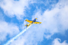 A small sport plane flying in the sky. royalty free stock image