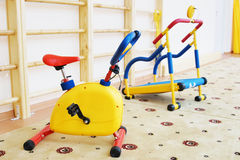Small sport simulators in a kindergarten gymnastic hall Royalty Free Stock Images