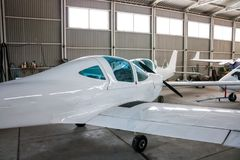 Small sports airplanes in a hangar royalty free stock photos