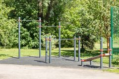 Small sports complex, horizontal bar, next to a modern residential complex, fitness, training, sports royalty free stock images