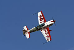 Small sports plane when performing aerobatics Stock Image