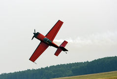 Small sports plane when performing aerobatics Stock Photo