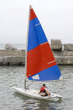 Small sports yacht. Children's sailing - the small sports yacht Stock Photography