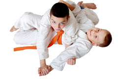 Small sportsmen training techniques hold hands Stock Image