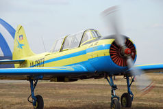 Small sporty single-seater with a rotating propeller Stock Photos