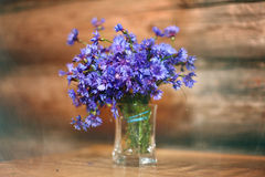 Small spring flowers boquet glass. Sawg royalty free stock image
