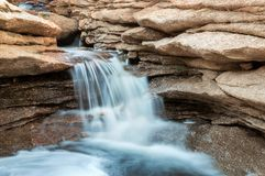 Small springtime waterfall in desert mountains Royalty Free Stock Image