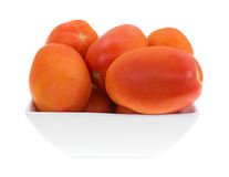 Small square bowl filled with roma tomatoes Royalty Free Stock Image