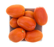 Small square bowl filled with roma tomatoes Royalty Free Stock Photography