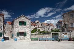 Small square in an idyllic, mediterranean village. Šepurine on island of Prvić, Adriatic Sea, Croatia. Old, historic settlement is crowded with stone stock photo