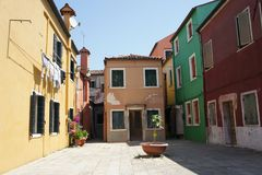 Small square with old colorfull houses in Burano royalty free stock photography