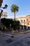 Small square with palm trees, streets of Cagliari downtown, Sardinia Royalty Free Stock Photos
