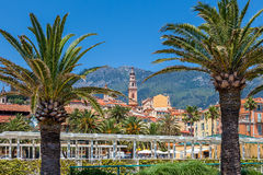 Small square, palms and colorful houses in Menton. Royalty Free Stock Photos