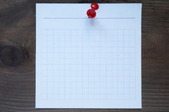 Small square piece of paper pinned to the wall Royalty Free Stock Photo