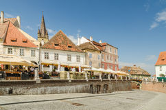 The Small Square In Sibiu. SIBIU, ROMANIA - AUGUST 25: The Small Square on August 25, 2013 in Sibiu, Romania. It is one of the most important cultural centers of Stock Images