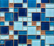 Small square tiles of blue. Color stock photos