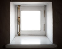 Small square window. In the wall of old European house Royalty Free Stock Photography