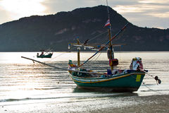 Small squid fishing boat at pranburi beach in the Stock Photo