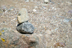 Small stack of pebble stones. Small balanced stack of pebble stones on a stony beach stock photos