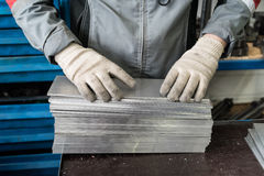 Small stack of steel plates on the bench miller, hand in working Royalty Free Stock Photography