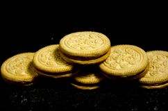 The small stack of sweet round cookie`s. A cookie is a baked or cooked food that is small, flat and sweet. It usually contains flour, sugar and some type of oil Stock Photo