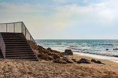 A stairs leading to the sea shore stock photos