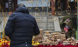 Small stalls selling traditional toys. In February 2017, it was a Chinese new year and the Confucius Temple in Nanjing, China sold a small stand of traditional stock images