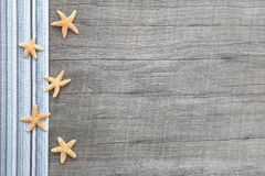 Small starfishes on grey wooden shabby chic background Stock Photo