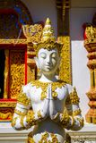 Small statue of Buddha. In front of a Buddhist temple near Mae Sai, north Thailand stock photo