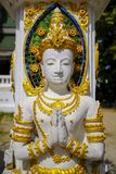 Small statue of Buddha. In front of a Buddhist temple in Pai, north Thailand royalty free stock images