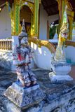 Small statue of Buddha. In front of a Buddhist temple in Pai, north Thailand stock photo