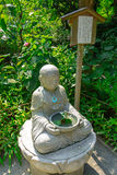 Small statue of Buddhist figure in Japanese Temple Stock Photo