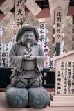 Small statue at Jinja-Jishu shrine inside the famous Kiyomizu-dera Buddhist Temple in Kyoto. Okuninushi -god of love- statue at Jinja-Jishu shrine inside the royalty free stock photo