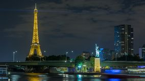 The small Statue of Liberty located near the Eiffel tower night timelapse. Paris, France. The small Statue of Liberty located near the Eiffel tower night stock footage