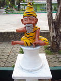 Small statue of an old yoga man Stock Photography