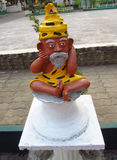 Small statue of an old yoga man Stock Image