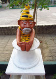 Small statue of an old yoga man Stock Photo