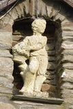 Small Statue in wall. Of farm building Trentishoe, Exmoor, Devon, UK stock images