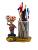 Small statuette of a mouse. A small statuette of a mouse on a white background with pens and pencils Stock Photos