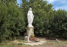 Small stature of the Virgin Mary in a park in Alberobello, Italy stock photos