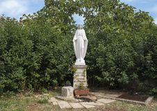 Small stature of the Virgin Mary in a park in Alberobello, Italy stock photo
