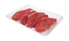Small steaks on white meat tray. Several small sized steaks grouped on a white meat tray royalty free stock photography