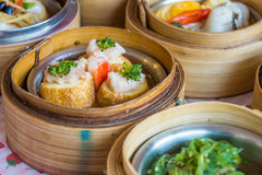Small steamer baskets of Dim Sum in restaurant Royalty Free Stock Photography