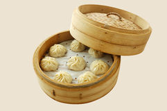 Small steamer buns. Yumcha.   dim sum in bamboo steamer with chinese bun , pao , bao zi , steamed dumpling , shumai on table in chinese restaurant. chinese Stock Photo