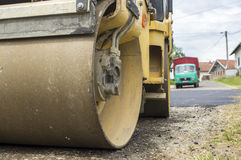 Small steamroller on road royalty free stock image
